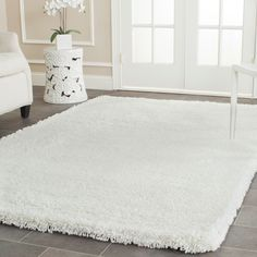 This comfortable white shag rug will provide softness against your bare feet. Made from acrylic, it comes in a white color that will act like a neutral element in most interior designs. It works well both as an accent and as an area rug.