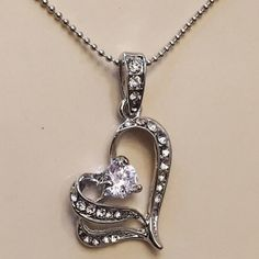 """Swarovski Heart Necklace. 23"""" long chain. Swarovski Crystal heart necklace. Silver tone. New but does not come with tags. None Jewelry Necklaces"""