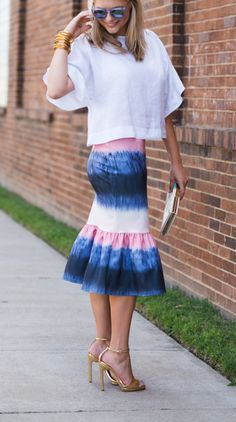 Add the perfect pop of color to your look with this tie-dye peplum skirt