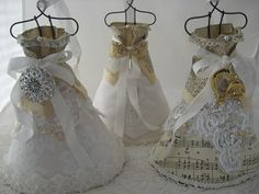 these look like mini wedding dresses ... would be cute for vintage themed bridal shower decor