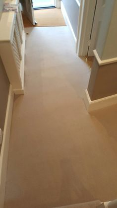 Beige Carpet to Stairs in Living Room