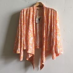 | NWT Alternative Apparel Cardigan Brand new with tags beautiful light tangerine, peach, strawberry and cream open cardigan.  Features 3/4 bell sleeves.  100% cotton.  In new condition. Alternative Apparel Sweaters Cardigans