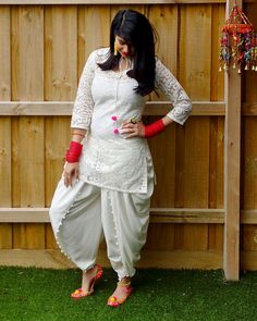 dhoti with pom poms! email sajsacouture@gmail.com to place your order
