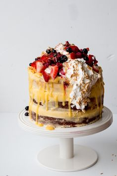 lemon coconut berry layer cake with lemon curd and meringue   @andwhatelse