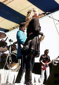 Billy Burnette, Stevie and John McVie onstage outdoors; love Stevie's short layered frilled skirt, thick leggings and boots here   ~        ☆♥❤♥☆         ~   http://rockonancientqueen.tumblr.com/post/6698981771