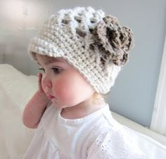 Crochet baby hat by Haley Abigail - no pattern or links at this site (and her Etsy shop looks shut at the moment).  Pinned because it was too sweet to leave / ideas.