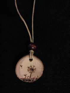Dandelion pyrography necklace by Sandy Blanc for sale on Etsy