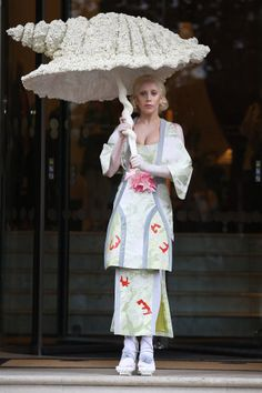 On Halloween, Lady Gaga was seen in a floral kimono-inspired dress, which she accessorized with an umbrella in the shape of a seashell.