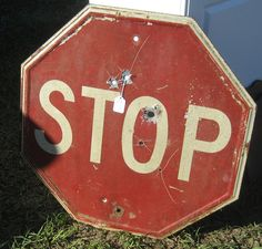 Vintage stop sign complete with bullet holes.