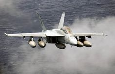 US Navy Boeing F-18F Super Hornet with regular tanks, before fitting of conformal body tanks.