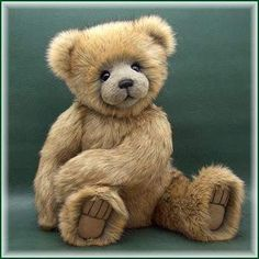 """Brodrick By Teddy Kingdom - Please meet a large, 25 inch, furry bear cub named Brodrick. He was made of 2"""" pile dense and very soft tipped synthetic fur with guard hair. He has black glass eyes with upper and lower eyelids. His nose is hand embroidered Pearl cotton. His paws are made of leather. He is stuffed wi..."""