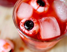 Bloody lychee eyeball cocktails: Bloody lychee-olive eyeballs float in these simple tonic cocktails.