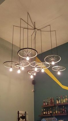 Green ideas to recycle bike parts for unique lighting fixtures chandeliers made out of recycled bike parts icreatived Vintage Industrial Lighting, Unique Lighting, Home Lighting, Club Lighting, Lighting Ideas, Outdoor Lighting, Task Lighting, Garage Lighting, Progress Lighting