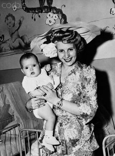 Eva Peron Posing with baby in Madrid, 1947.