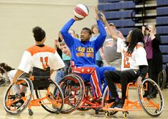 """Harlem Globetrotter Anthony """"Buckets"""" Blake looks for someone to pass the ball to while playing a game with the Houston County Sharks wheelchair basketball team at Northside High School Thursday."""