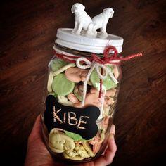 Diy dog treats container: mason jar, glue, dog shaped toys, spray paint, blackboard paint
