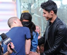 Siva of The Wanted looks on as the girl is kissed by Max George