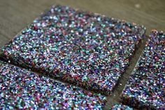 """Nothing screams """"adulthood"""" like a stack of stylish coasters at the ready to put under your friends' PBR cans. These DIY tile coasters will keep your drink budget and coffee table (if you even have one) intact. Coaster Crafts, Diy Coasters, Scrabble Coasters, Photo Coasters, Ceramic Tile Crafts, Glitter Tiles, Gold Glitter, Glitter Crafts, Glitter Projects"""