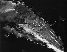 The carrier 'Zuiho' under attack by an American dive bomber. Note the camouflage used to make the carrier appear as a destroyer mid-turn when seen from above. Leyte Gulf, 1944 In the Shadow of Leaves Military News, Military History, Les Philippines, Leyte, Imperial Japanese Navy, Uss Enterprise, Submarines, Aircraft Carrier, War Machine