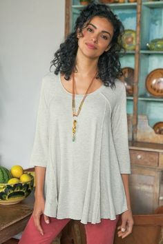 The easiest top of the season, bar none. Fashioned of rayon and spandex jersey for graceful drape with just the right touch of stretch, the relaxed tunic is simply styled with a banded scoop neck, 3/4 sleeves and angled seaming. Riley Tunic - Item #2AE55