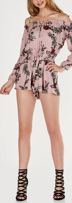 Lightweight printed romper with cold shoulder cut outs and floral patterns throughout. Flowy fit with elastic bands for comfort and fit. - 100% Rayon - Imported - Model is wearing size S - Runs true t