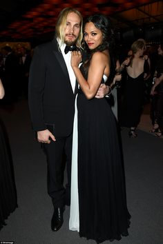 Smitten: Wearing black and white, new mum Zoe Saldana cuddled up close to her handsome man Marco Perego inside the party