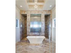 5876 Sunnyslope, Naples, Fl 34119 | Gorgeous master bathroom with soaking tub, walk through shower with reeded glass | Quail West in Naples, Florida  - Melinda Gunther