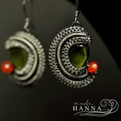 These delicate 2.5cm waning and waxing moon earrings feature beautiful faceted vesuvianite in brilliant green, with a perfectly complimentary bright orange faceted carnelian. Each earring is wire wrapped by hand using many feet of .999 fine silver wire. The sterling silver ear hooks are perfect f...