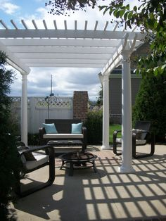 This is a freestanding vinyl pergola with round colums Vinyl Pergola, Pergola With Roof, Pergola Plans, Pergola Kits, Carport Kits, House Front, Vines, Yard, Outdoor Structures