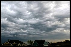 """""""Turbulent motions between differing air masses create undulating clouds over Kansas in 2006.  Meteorologists are proposing these clouds be designated ... 'Undudlus Asperatus.'"""" This would be the first new cloud type named in over 50 years.    - photo by Jane Wiggins"""
