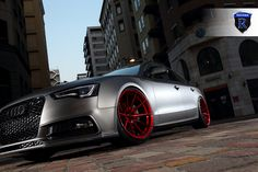 Here are a few pictures of a matte Audi A5 Sportback with Rohana RF1 Wheels. The wheels are painted gloss Red and are 20x11 All Around.