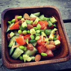 Pre Dinner Salad! Cucumber, almonds, tomato, edamame, green onion, avocado, and Italian dressing!