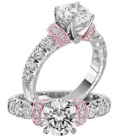 Here's an engagement ring with just a splash of pink color: Designed by Jack Kelege, this setting is made of 18k white gold with rose gold accents and 0.83 cts. t.w. round white diamonds