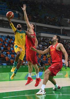 Australia's guard Patty Mills jumps to score past Spain's small forward Victor…