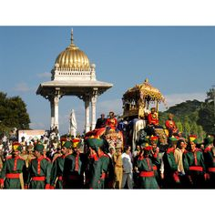 Atop an elephant the goddess Vhamuneshvari is feted in immense procession on Dussehra, Mysore, Karnataka.