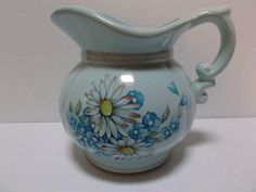McCoy Pottery Pitcher circa mid 1970's Powder Blue Flowers Daisies  offered by #rubylane shop Saltymaggie's Treasures