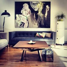 wood, coffee table and quilted grey sofa