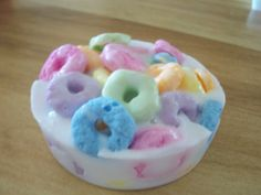 """I'd like to try my hand at soapmaking, does anyone know which colours were used in this Fruit Loop scented soap please? Is it possible to get natural Froot Loops fragrance? Does adding laevo-linalool enhance the scent? Can anyone recommend the best recipe/kit for high-lather small hand/guest soaps?  And if you ship soaps out of Canada, how do you keep everything under 2cm thick (to beat Canada Post's """"Slot of Doom""""). Thanks for any tips! :)  Fruit Loops soap by mostlee on Etsy"""