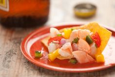 Shrimp and Mango Ceviche | This fully cooked, brightly flavored ceviche is good enough to eat all by itself, piled into bowls over shredded lettuce and served as an appetizer or light lunch. But don't hesitate to scoop it up with tortilla chips, too.