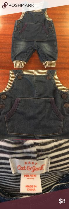 Newborn Cat & Jack Overalls Soft denim overalls for newborn. All snaps work. Strips on bottom hem are gray and white. Cat & Jack One Pieces