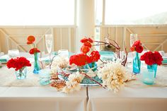 beach wedding centerpiece, red and aqua // photo by Robyn Van Dyke Photography // decor Bells & Whistles // Venue The Currituck Club
