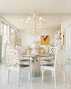 Mirrors and metallic surfaces add shimmer to an all white dining room.