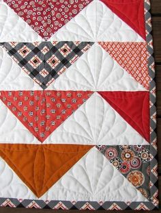 Flying Geese quilt by Dea Larson as seen at Hawthorne Threads Blog