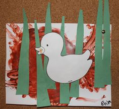 One Duck Stuck in the Muck story turned into an art project with brown finger paint, paper grass and a white duck.
