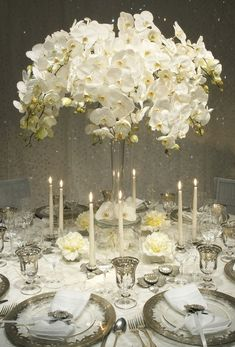 Elegant winter white orchid wedding tabletop