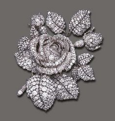 FORMERLY THE PROPERTY OF PRINCESS MATHILDE (1820-1904), NIECE OF NAPOLEON BONAPARTE, THE TUDOR ROSE, A DIAMOND-SET BROOCH BY THEODORE FESTER, PARIS, C. 1855.  Set with old mine-cut and rose-cut diamonds, mounted in silver-plated gold. Acquired by Cartier in 1904 and sold to Mrs. Cornelius Vanderbilt.