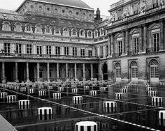 """Daniel Buren, """"Les deux plateaux"""". Travail in situ permanent, 1985 - Juillet 1986. Cour d'honneur du Palais-Royal, Paris, France."""
