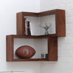 """Tronk Design Franklin Shelf The award nominated Franklin Shelf is a 90 degree corner shelf. This unique design allows for maximum storage space, while occupying a very small area. The smooth wooden finish of this shelf will make a great addition to any corner, table, or desktop. Its sturdy build allows it to be hung or stand on its own. Description Features Wall mounting hardware: """"L"""" brackets Mounted to wall using the L brackets and screws Product Details Material: Solid Wood Wall Mounting…"""