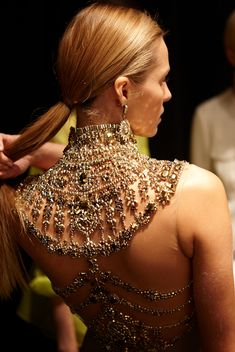 Exquisite detail backstage at the Ralph Lauren Spring 2015 Collection show.