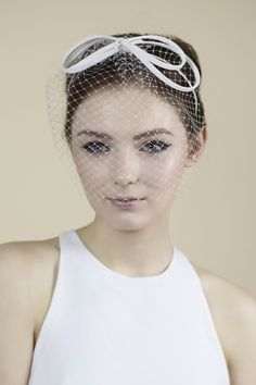 Our Ailis blusher veil or 'birdcage veil', is made from white Russian  veiling and a delicate silk bow, then finished with a small lace droplet in  the centre.  Attaches with a headband for ease.  Can be made in other colours on request.  Made to order.
